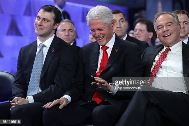 Former US President Bill Clinton laughs with US Vice President nominee Tim Kaine as Marc Mezvinsky looks on during the fourth day of the Democratic...