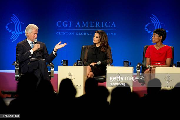 Former US President Bill Clinton left speaks during a panel discussion as Eva Longoria actress and founder of The Eva Longoria Foundation center and...