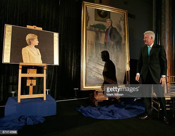 Former US President Bill Clinton looks at his and his wife's portraits US Senator Hillary Clinton during an unveiling ceremony at the Smithsonian...