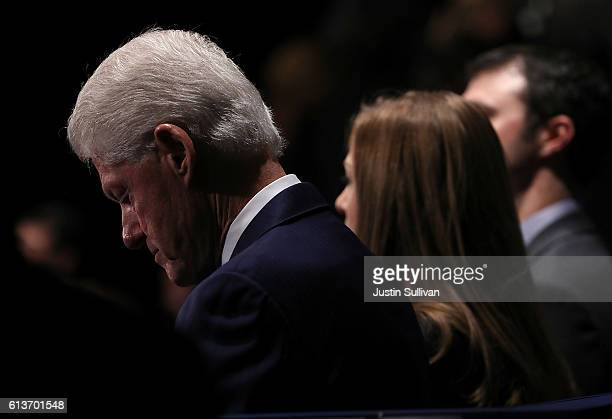 Former US president Bill Clinton looks on during the second presidential debate with democratic presidential nominee former Secretary of State...