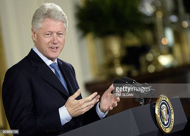 Former US president Bill Clinton makes remarks during the unveiling of his official White House portrait 14 June 2004 in the East Room of the White...