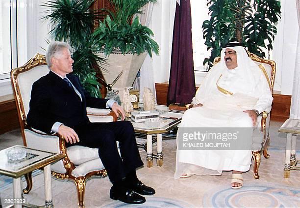 Former US president Bill Clinton meets with Qatar's Emir Sheikh Hamad bin Khalifa alThani in Doha 12 January 2004 Addressing the closing session of...