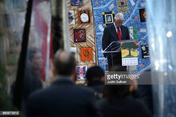 Former US president Bill Clinton pauses as he delivers the keynote address during the World AIDS Day commemoration event at the National AIDS...