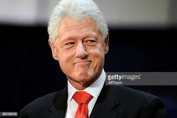 Former US President Bill Clinton pauses while speaking at a rally in support of Democratic presidential nomineee U.S. Sen. Barack Obama October 12,...