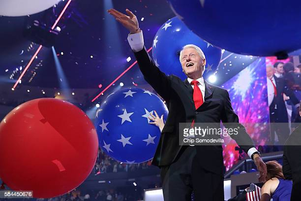 Former US President Bill Clinton plays acknowledges the crowd at the end of the fourth day of the Democratic National Convention at the Wells Fargo...