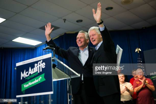 Former US President Bill Clinton R and Virginia gubernatorial candidate Terry McAuliffe wave to the crowd during a campaign event for McAuliffe at...