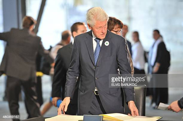 Former US President Bill Clinton readies to sign the condolence book at Potocari memorial center prior to burial ceremony in Potocari Memorial...