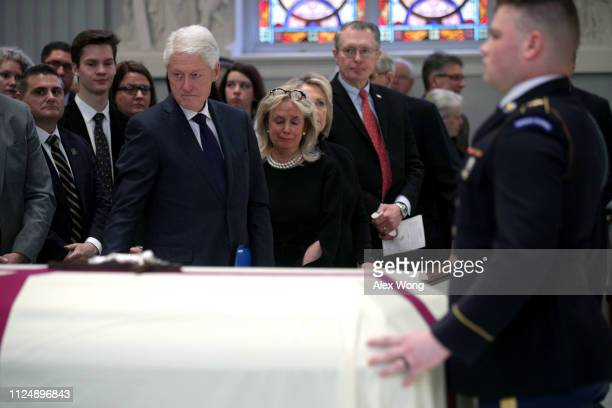 Former U.S. President Bill Clinton, Rep. Debbie Dingell , and former Secretary of State Hilary Clinton attend the funeral mass for former Rep. John...