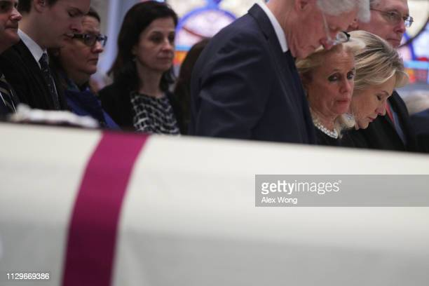 Former U.S. President Bill Clinton, Rep. Debbie Dingell , and former Secretary of State Hillary Clinton attend the funeral mass for former Rep. John...
