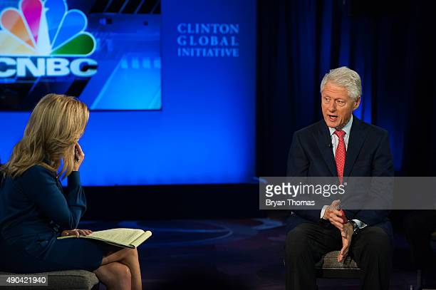 Former US President Bill Clinton right speaks with CNBC's Becky Quick left during the Clinton Global Initiative Annual Meeting at the Sheraton Hotel...
