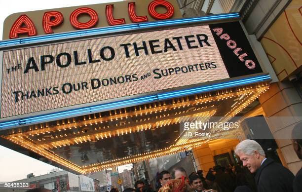 Former US President Bill Clinton shakes hands outside Harlem's Apollo Theater during a celebration of the first phase of restoration of the theater...