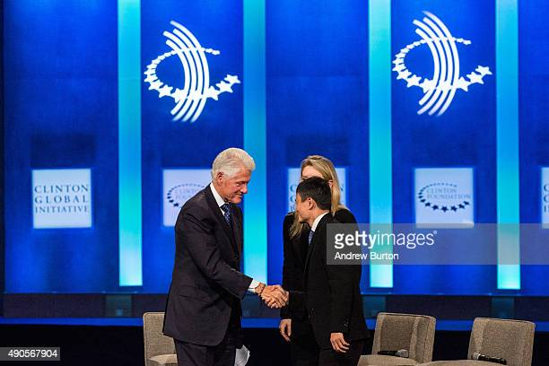 Former US President Bill Clinton shakes hands with Jack Ma executive chairman of Alibaba Group at the Clinton Global Initiative's closing session on...