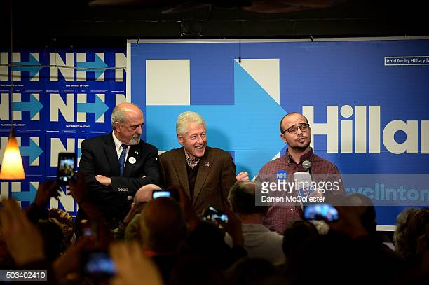 Former US President Bill Clinton sits beside the former mayor of Dover George Maglaras as he is introduced by Ben Haynes at Hillary Clinton Dover...