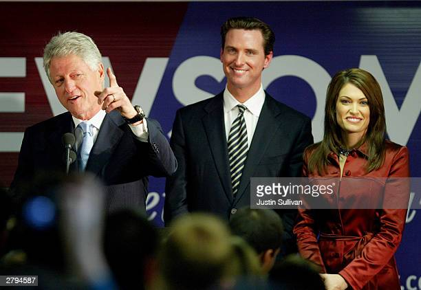 Former US President Bill Clinton speaks at a campaign rally for San Francisco mayoral candidate Gavin Newsom as Newsom's wife Kimberly...