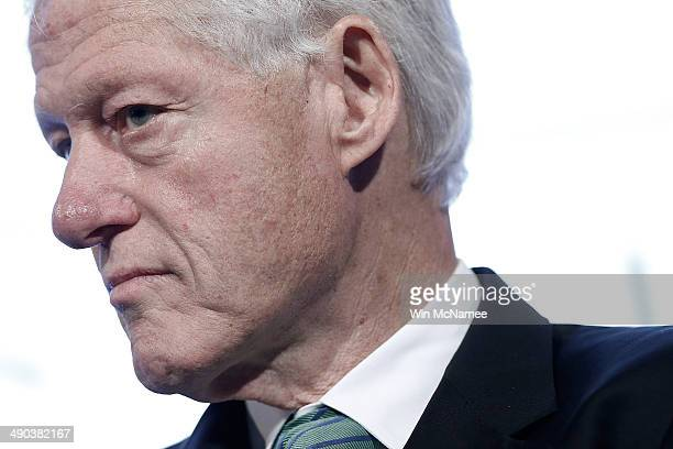 Former US President Bill Clinton speaks at the Peter G Peterson Foundation's fifth annual fiscal summit on Our Economic Future on May 14 2014 in...