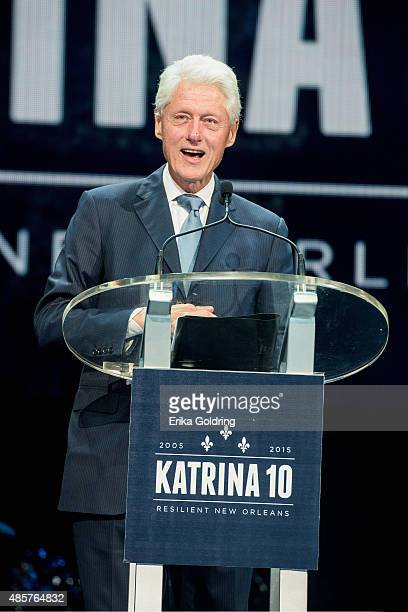Former US President Bill Clinton speaks during a Hurricane Katrina 10th anniversary event at the Smoothie King Center on August 29 2015 in New...
