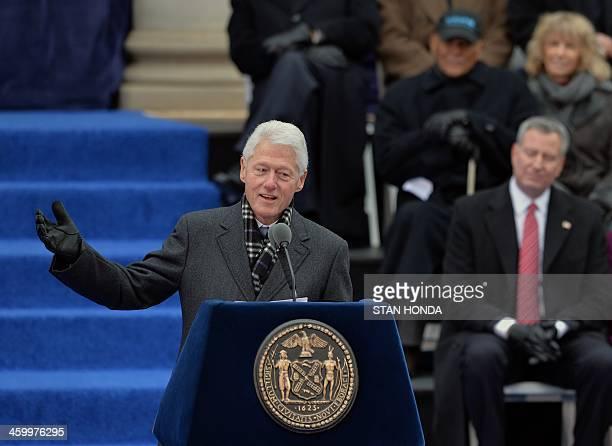 Former US President Bill Clinton speaks just before swearing in Bill de Blasio as New York City Mayor on the steps of City Hall in Lower Manhattan...