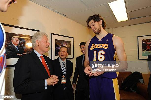 Former US President Bill Clinton speaks to Pau Gasol of the Los Angeles Lakers on January 22 2010 at Madison Square Garden in New York New York NOTE...