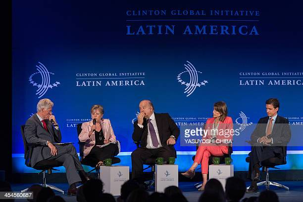 Former US President Bill Clinton speaks with Alicia Barcena Executive Secretary of the United Nations Economic Commission for Latin America and the...