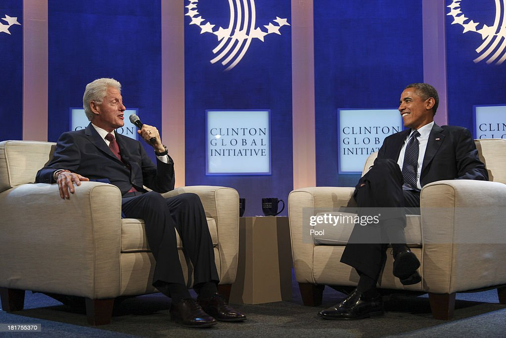 Former U.S. President Bill Clinton (L) speaks with U.S. President Barack Obama on stage during the annual Clinton Global Initiative (CGI) meeting on September 24, 2013 in New York City. Timed to coincide with the United Nations General Assembly, CGI brings together heads of state, CEOs, philanthropists and others to help find solutions to the world's major problems.