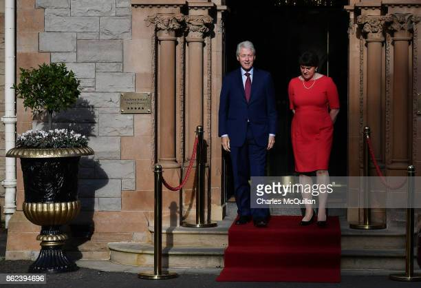 Former US President Bill Clinton stands alongside DUP leader Arlene Foster at the Culloden Hotel following a private meeting on October 17 2017 in...