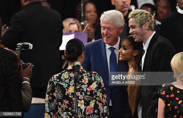 Former US President Bill Clinton takes a picture with singer Ariana Grande and her fiancee Pete Davidson at Aretha Franklin's funeral at Greater...