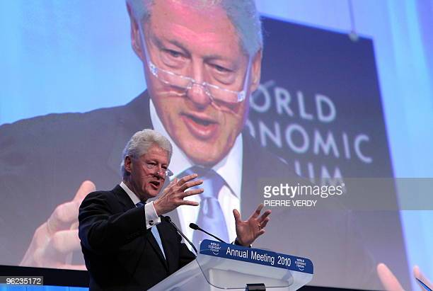 Former US president Bill Clinton talks during the Special Session on Haiti on the second day of the World Economic Forum meeting in Davos on January...
