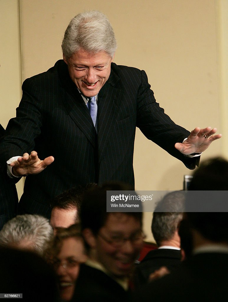 Former U.S. President Bill Clinton tries to quiet a cheering crowd during the American Jewish Committee's annual meeting May 6, 2005 in Washington, DC. The group also presented its Light Unto the Nations Award to Clinton for his tsunami relief efforts.