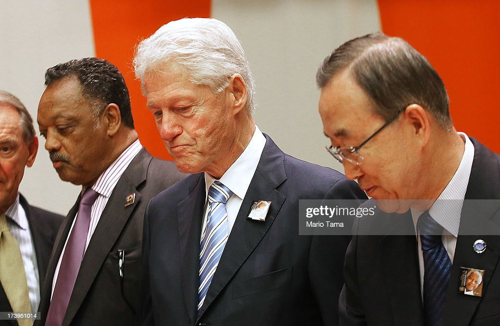 Former U.S. President Bill Clinton (C), United Nations Secretary-General Ban Ki-moon (R) and Rev. Jesse Jackson stand before the start of an informal meeting of the plenary of the General Assembly, on the commemoration of the Nelson Mandela International Day, at U.N. headquarters on July 18, 2013 in New York City. South Africa's first black president and anti-apartheid leader turns 95 today on his 41st day in the hospital.