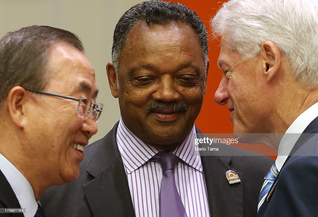 Former U.S. President Bill Clinton (R), United Nations Secretary-General Ban Ki-moon (L) and Rev. Jesse Jackson speak before the start of an informal meeting of the plenary of the General Assembly, on the commemoration of the Nelson Mandela International Day, at U.N. headquarters on July 18, 2013 in New York City. South Africa's first black president and anti-apartheid leader turns 95 today on his 41st day in the hospital.