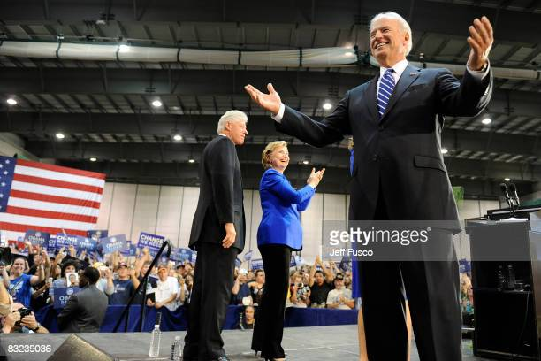 Former US President Bill Clinton US Sen Hillary Clinton and Democratic vice presidential candidate US Senator Joe Biden greets supporters at a rally...