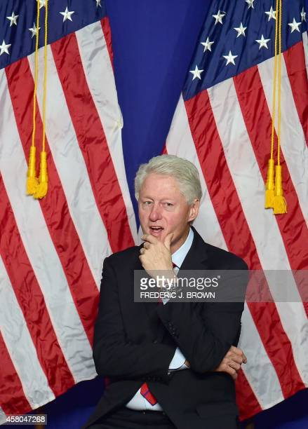 Former US President Bill Clinton waits to speak in support of California Democrats during a Get Out The Vote rally in Oxnard California on October 29...