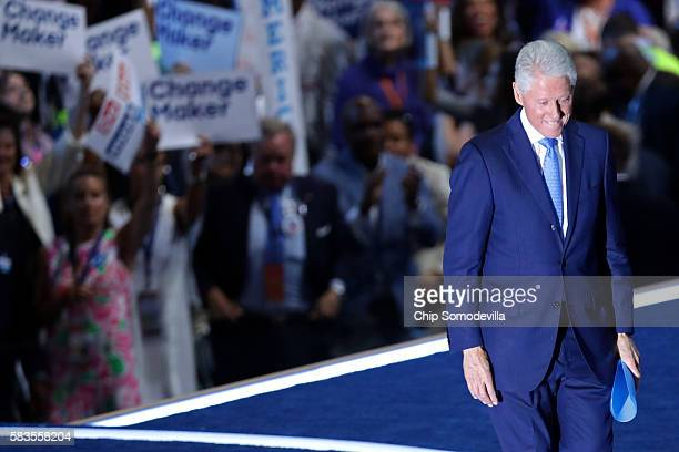 Former US President Bill Clinton walks off stage after delivering remarks on the second day of the Democratic National Convention at the Wells Fargo...