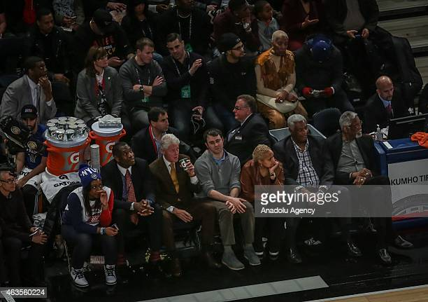 Former US President Bill Clinton watches the basketball match between Western Conference AllStar Team and Eastern Western Conference AllStar Team as...