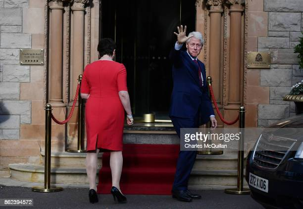 Former US President Bill Clinton waves as he stands with DUP leader Arlene Foster at the Culloden Hotel following a private meeting on October 17...