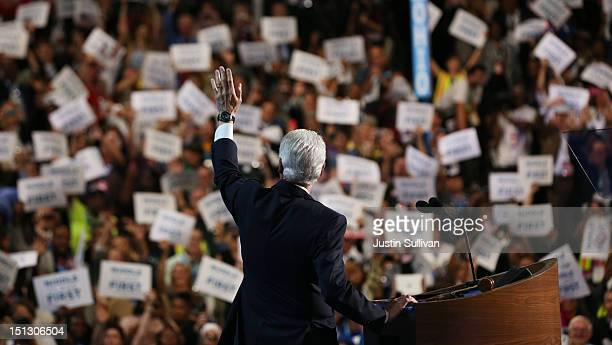 Former US President Bill Clinton waves as he takes the stage during day two of the Democratic National Convention at Time Warner Cable Arena on...