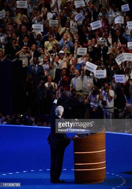 Former US President Bill Clinton waves on stage during day two of the Democratic National Convention at Time Warner Cable Arena on September 5 2012...