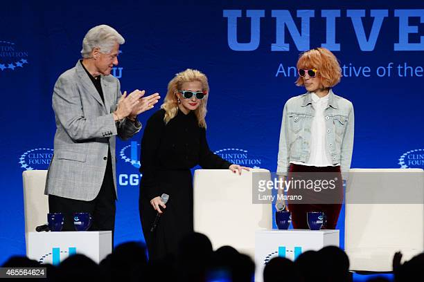 Former US President Bill Clinton welcomes Maria Alekhina and Nadezhda Tolokonnikova of Pussy Riot during the Clinton Global Initiative University at...