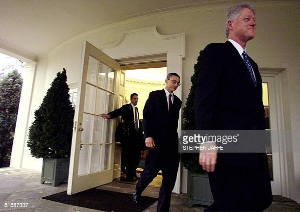 Former US President Bill Clinton with his Chief of Staff John Podesta and his aid Doug Band leaves the Oval Office of the White House for the last...