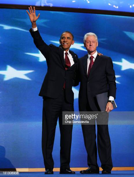 Former US President Bill Clintonstands with Democratic presidential candidate US President Barack Obama on stage during day two of the Democratic...