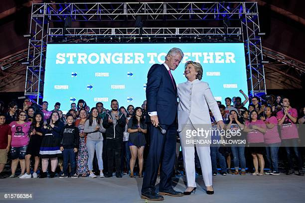TOPSHOT Former US President Clinton and Democratic presidential nominee Hillary Clinton stand together while speaking to supporters at Craig Ranch...