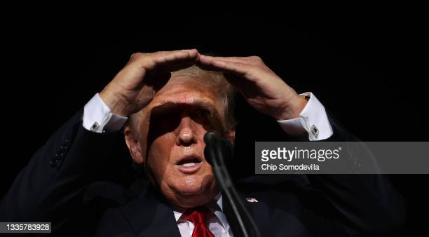 """Former U.S. President Donald Trump addresses supporters during a """"Save America"""" rally at York Family Farms on August 21, 2021 in Cullman, Alabama...."""