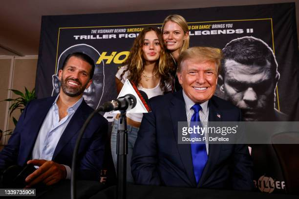 Former US President Donald Trump and Donald Trump Jr pose for a photo prior to the fight between Evander Holyfield and Vitor Belfort during Evander...