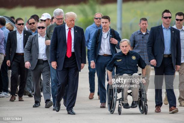 Former US President Donald Trump arrives with Texas Governor Greg Abbott for a visit to the border wall near Pharr, Texas on June 30, 2021. - Former...
