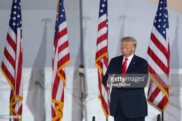 Former US President Donald Trump greets the crowd at a rally on September 25, 2021 in Perry, Georgia. Republican Senate candidate Herschel Walker,...