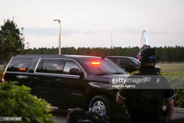Former U.S. President Donald Trump leaves in his motorcade the Hyatt Regency Hotel after speaking at the Conservative Political Action Conference, in...