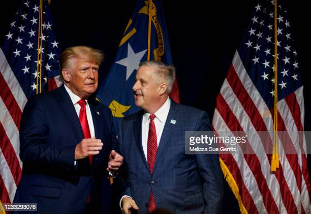 Former U.S. President Donald Trump, left, takes the stage with NCGOP Chairman Michael Whatley after being announced at the NCGOP state convention on...