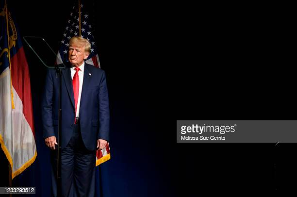 Former U.S. President Donald Trump listens to Laura Trump tell the crowd she has decided not to run for the N.C. Senate at the NCGOP state convention...