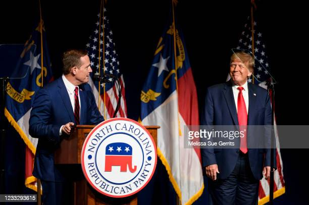 Former U.S. President Donald Trump listens to Ted Budd announce he's running for the NC Senate at the NCGOP state convention on June 5, 2021 in...