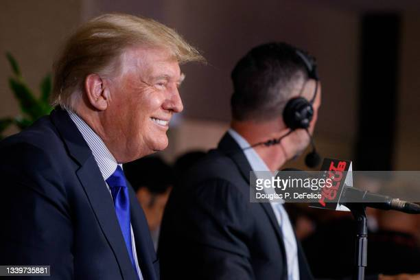 Former US President Donald Trump looks on prior to the fight between Evander Holyfield and Vitor Belfort during Evander Holyfield vs. Vitor Belfort...